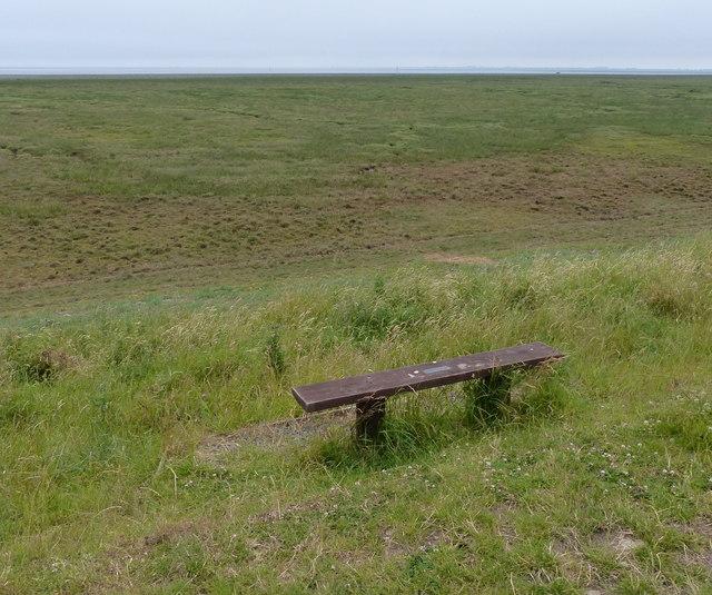 Seat overlooking the salt marsh at Freiston Low