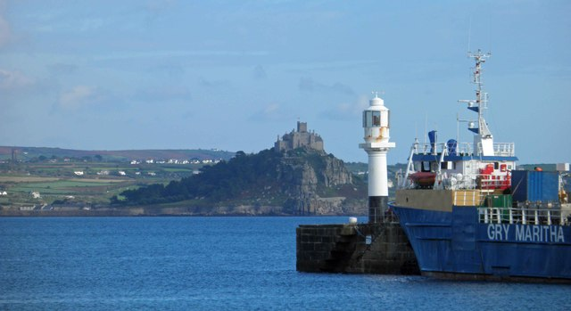 The lighthouse on Penzance South pier with St. Michael's Mount in the background