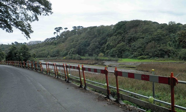 Temporary barriers to edge of  Maenporth Road
