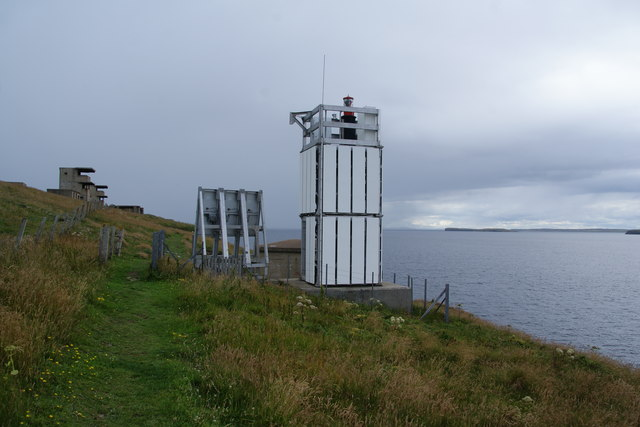 Modern lighthouse and older defences above Scarf Skerry