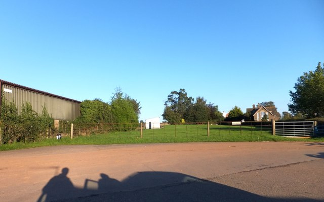 Car park for Copplestone farm shop and field beyond