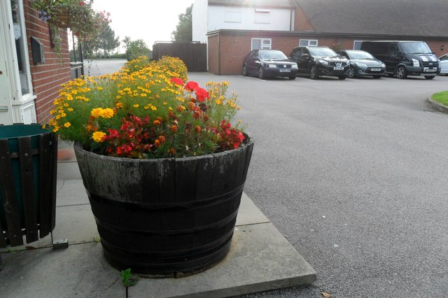 Half barrel of flowers, Premier Inn, Ansty