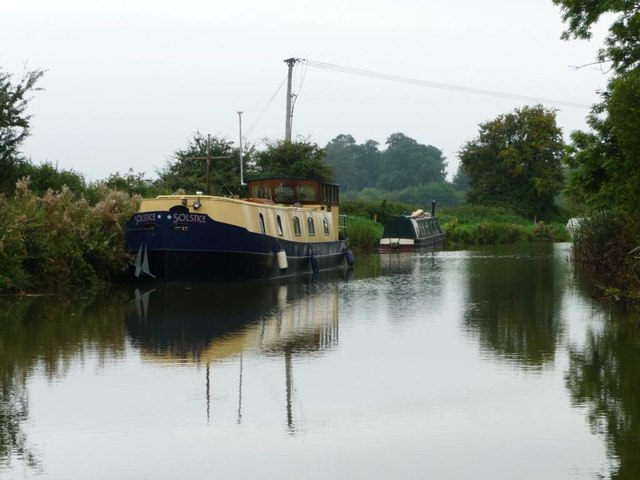 Wide-beam boat moored west of Pains Bridge [no 113]