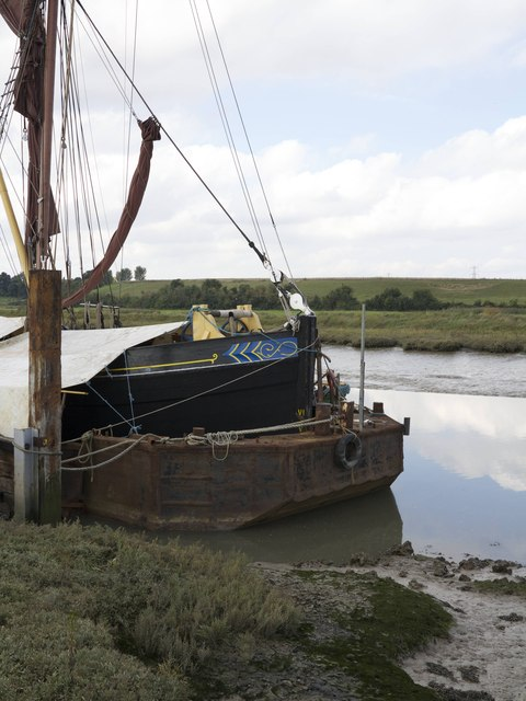 Thames Barge under restoration in floating dry dock on Oare Creek