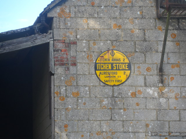 Old AA sign on lichen-spotted wall, Manor Farm, Itchen Stoke