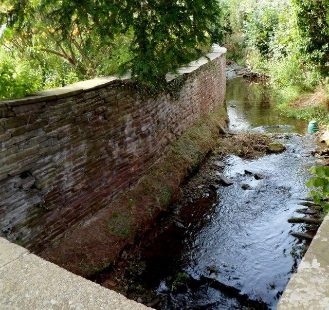 Brook flows under Church Road, Dorstone