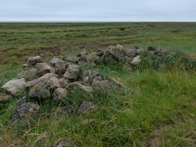 Pile of stones at the edge of the salt marsh