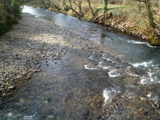 Afon Afan flows away from a footbridge in Cwmavon