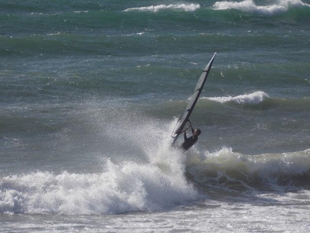Marazion: a surfer enjoys the waves