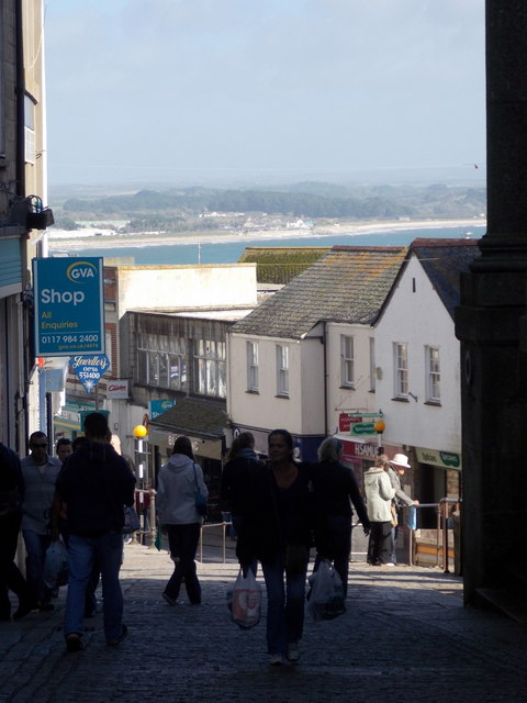 Penzance: sea glimpse over Market Jew Street shops