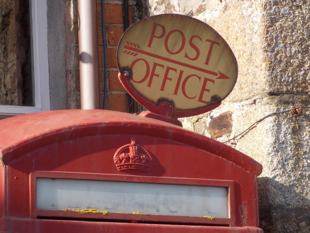 Mousehole: post office sign on phone box roof