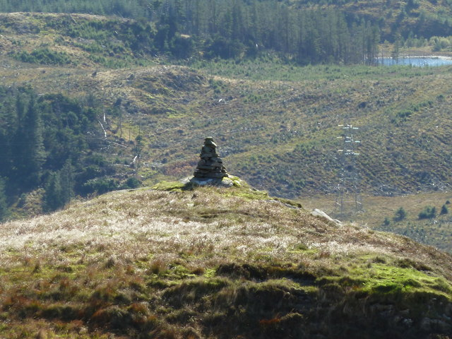 Cairn with view over electricity pylons