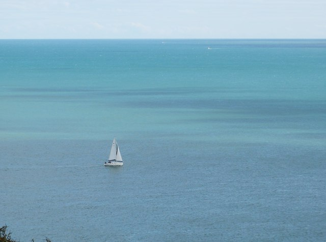 Sailing dinghy out in the bay
