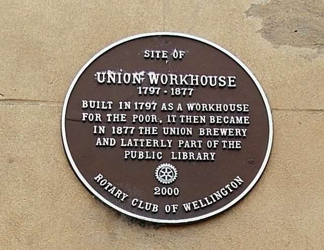Brown plaque recording the site of Union Workhouse, Wellington