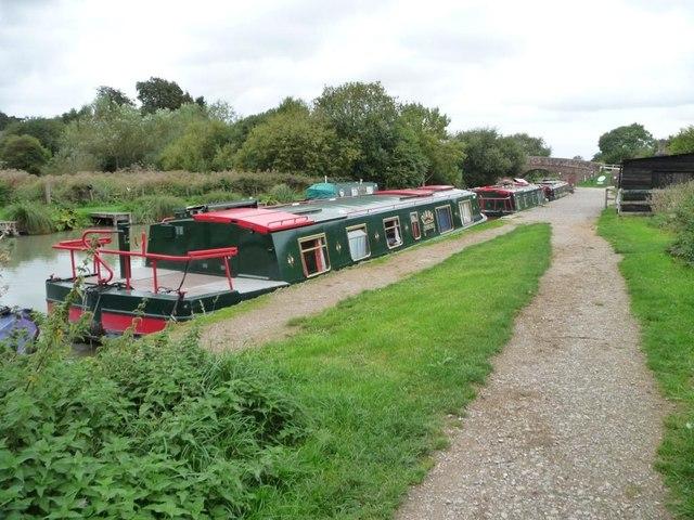 Three wide-beam boats, Great Bedwyn wharf
