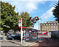 Dist:0.1km<br/>Two dragons on a pole by this bus stop in Salter Street. This area once had a large Cantonese population.