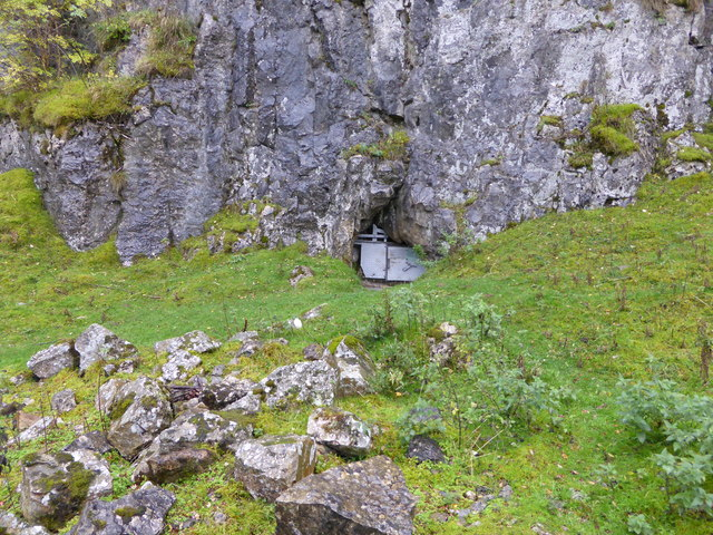 Cave entrance at the cliff base