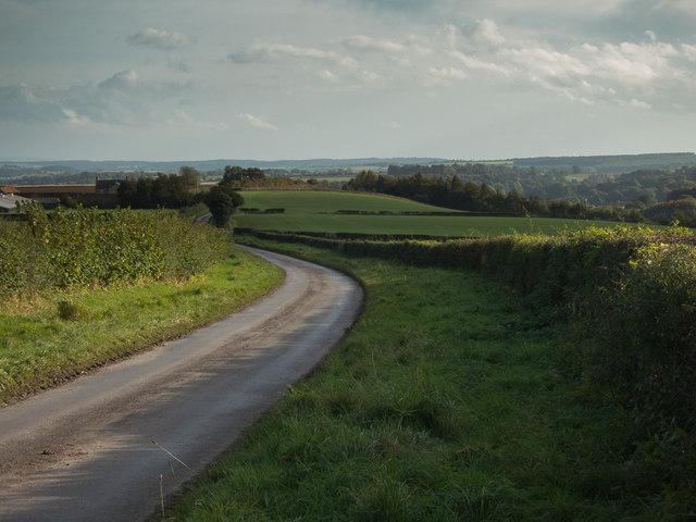 Minor road by Baxton's Grange