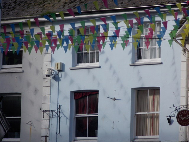 Falmouth: bunting and its shadows in Arwenack Street