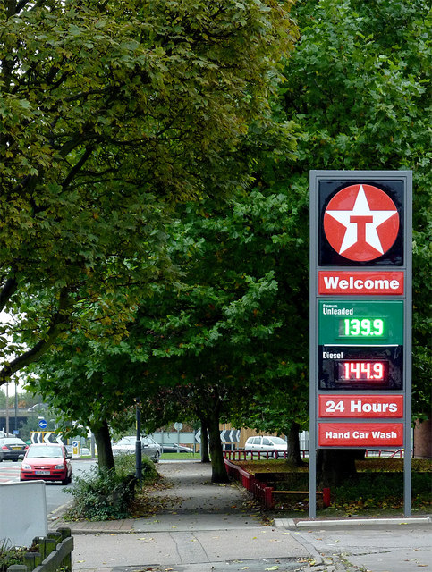 Fuel sign and trees in Owen Road, Willenhall, Walsall
