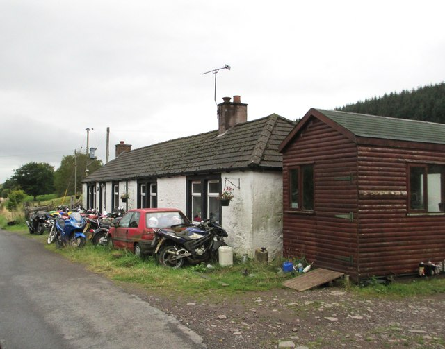 A cottage with motorbikes at Burnfoot