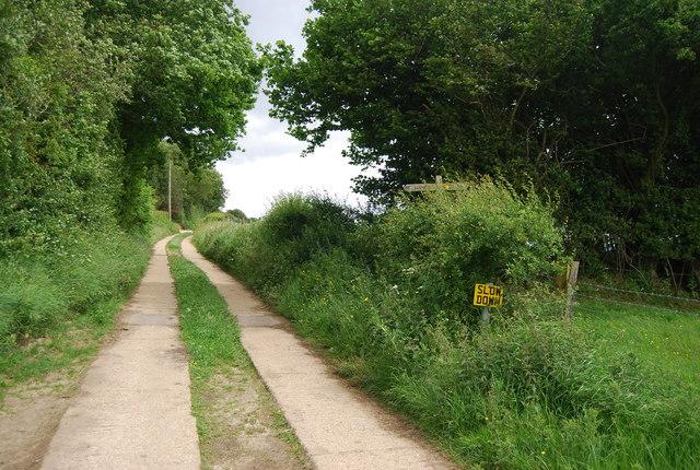 Slow down, footpath junction
