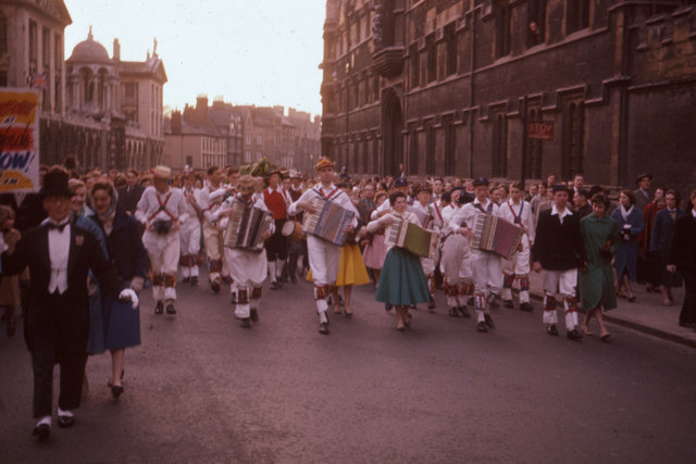 Morris dancers lead crowd along The High, Oxford May Morning 1958