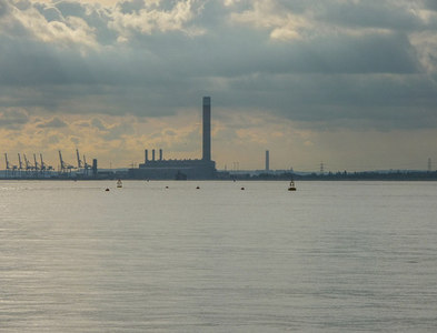 TQ8778 : Isle of Grain from Thames Estuary by Christine Matthews