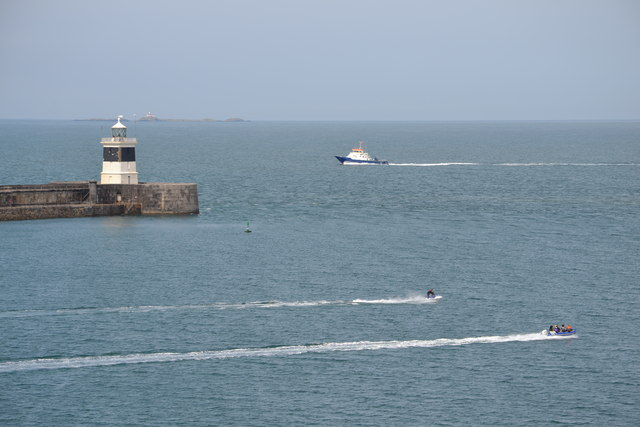 Breakwater Lighthouse and Locals, viewed from P&O's Adonia, docked at the Anglesey Aluminium Jetty, Holyhead