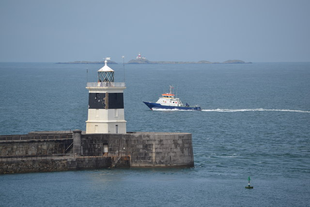 Breakwater Lighthouse and Smit Towy, viewed from P&O's Adonia docked at the Anglesey Aluminium Jetty, Holyhead