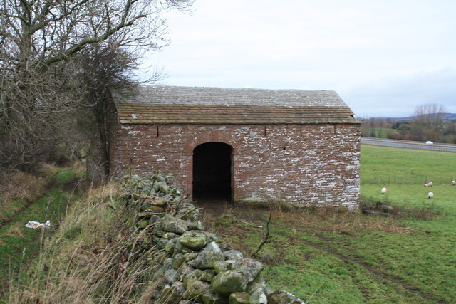 Stone barn by footpath