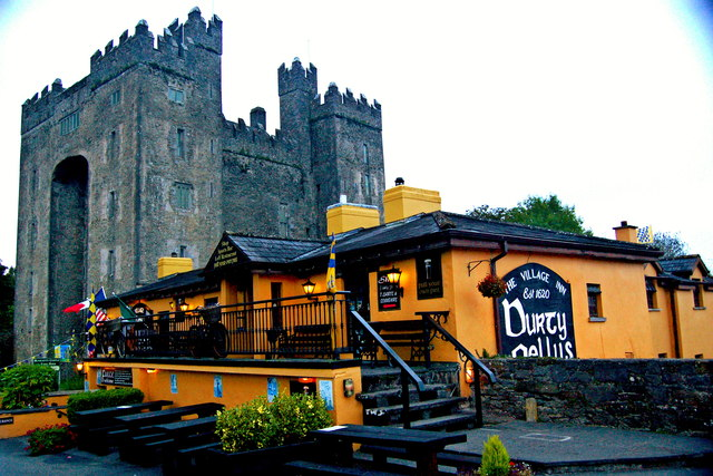 Bunratty - 15th Century Bunratty Castle & Front & NW Sides of Durty Nelly's Pub