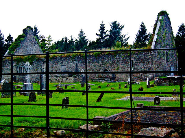 Derelict Bunratty Church & Graveyard beyond Steel Rod Fence at South End