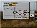 TL2159 : Roadsigns on the A428 Cambridge Road by Adrian Cable