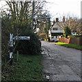 TL3044 : Abington Pigotts: High Street on Christmas morning by John Sutton