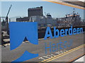NJ9406 : Aberdeen: reflections in the Harbour Office sign by Chris Downer