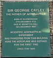 Photo of George Cayley green plaque