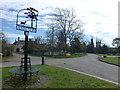 TF1005 : Village sign in Ashton by Richard Humphrey
