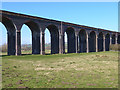"Dist:0.4km<br/>The much-photographed and much-Geographed 82-arch Grade II listed viaduct which carries the Oakham to Kettering line over the Welland valley. Since the 1960s, the line has been used only by freight trains and steam ""Specials"". But in 2009, a  passenger train service, one a day each way, was reinstated between Melton Mowbray and London St Pancras."