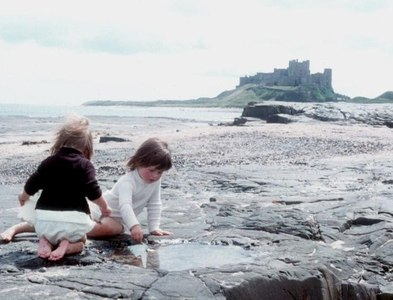 NU1735 : Enjoying the shore at Bamburgh by Alan Reid