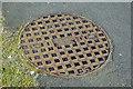 "J0053 : ""ACE"" manhole cover, Portadown (1) by Albert Bridge"