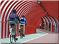 NS5765 : Cyclists in the covered walkway by Thomas Nugent