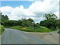 SP9506 : Junction on road to Wiggington by Robin Webster