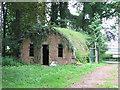 TG0714 : WW2 Asbestos hut in Hockering Wood by Evelyn Simak