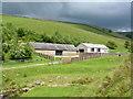 SJ9869 : Barns by Cumberland Brook by John Darch