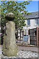Possible standing stone which has been moved and re-erected on more than one occasion. The round boulder on top was added by a local blacksmith in the 19th century.