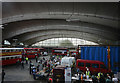 The reason for the presence of vintage buses and sales stands was that this was the Stockwell Garage Open Day on which the public were admitted to view the facilities provided by the garage. Its famous concrete vaulting seen here enabled the garage to represent the largest unsupported area (392 x 194 feet) under one roof in Europe at the time of its opening in 1952.