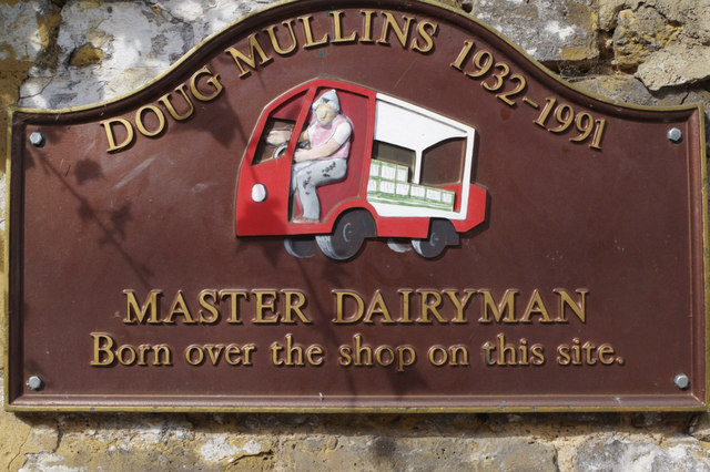 Doug Mullins brown plaque - Doug Mullins 1932-1991 Master Dairyman Born over the shop on this site.