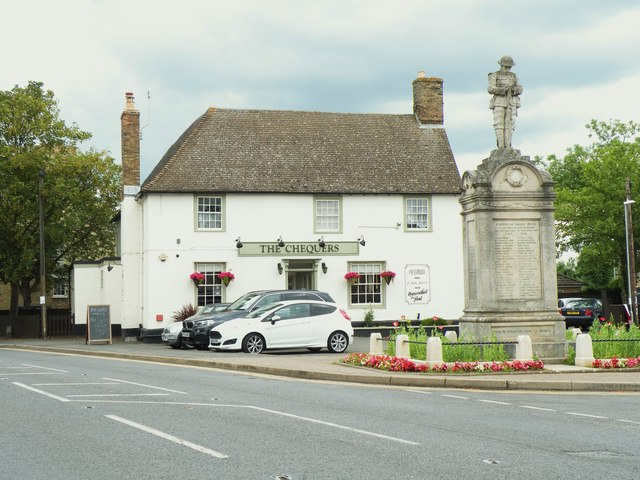 'The Chequers' inn and war memorial at Cottenham