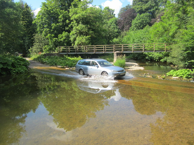 A car crosses the ford